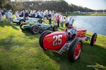 A view of the vintage race cars lined up around the Amelia Island Concours field. photo credit: Tara Hurlin