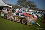 A long line of race cars displayed at the Amelia Island Concours d'Elegance. photo credit: Tara Hurlin