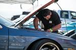 Jimmy Up Matsuri drift bash FC3S Mazda RX-7 owner working on car in pits