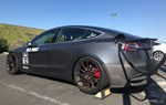 Unplugged Performance Tesla Model 3 dry carbon bumper photo credit: Andrew Modena