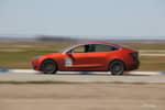 Orange wrapped Tesla Model 3 photo credit: Andrew Modena