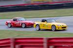 Honda S2000 vs. Miata at Gridlife Mid-Ohio photo credit: Tara Hurlin