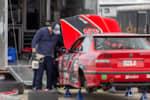 Gridlife Mid-Ohio GLTC competitor checking over his BMW mid-race. photo credit: Tara Hurlin