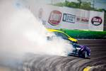 Chelsea Denofa initiates in chase behind Fredric Aasbo's Rockstar Energy Drink Toyota Corolla drift car photo credit: Valters Boze