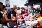 Ryan Tuerck greets fans during an autograph session at Formula Drift Orlando photo credit: Valters Boze