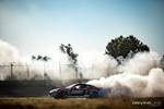 Ryan Tuerck's Nitto Tire smoke is backlit by the sun at the Orlando Speedworld race track photo credit: Valters Boze