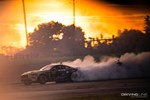 Vaughn Gittin Jr. slides his Monster Energy Ford Mustang RTR in Orlando as the sun sets in the early evening hours of Formula Drift round 2 photo credit: Valters Boze