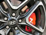 2019 Hyundai Veloster N brake caliper and rim.