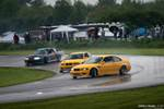 Gridlife Midwest Festival twin yellow E46 BMW M3s drifting in the rain
